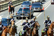 The horse cartege escorts the Presidential motorcade.