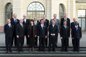 The President poses with world leaders for a class photo from the Conference on Progressive Governance.