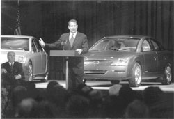 Photo: Al Gore Speaking in front of Energy Efficient Automobiles