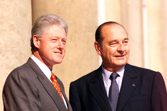 President Clinton and President Chirac smile at the crowd outside Elysee Palace.