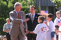 President Clinton and Chancellor Schroeder greet children in front of Cologne's Ludwig Museum, the site of Saturday morning's G-8 working sessions.