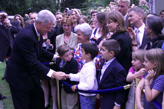 President Clinton greets a young admirer outside the ambassador's residence in Paris.