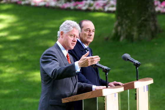 President Clinton answers a question during the press conference in the garden of Elysee Palace.