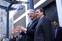President Clinton and Chancellor Schroeder of Germany greet a cheering crowd at the Gürzenich, a cultural center in Cologne.