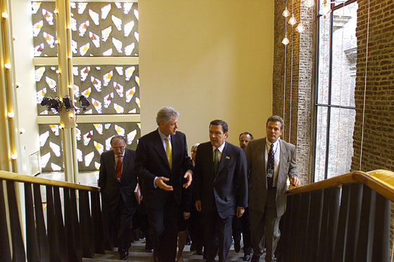 Inside the Gürzenich, President Clinton and Chancellor Schroeder confer as they head to their bilateral meeting.