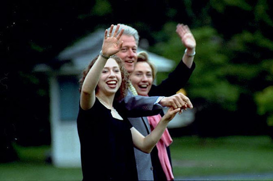 The President, First Lady, and Chelsea wave goodbye on the South Lawn of the White House.