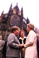 After the morning service, First Lady Hillary Rodham Clinton greets Mrs. Yeltsin outside the Cathedral.