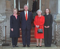 President Clinton, First Lady Hillary Rodham Clinton, and Chelsea Clinton pose for a photo with Queen Elizabeth II outside of Buckingham Palace.