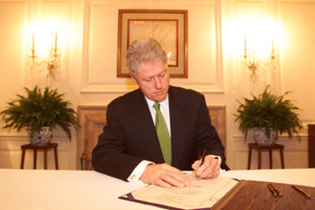 President Clinton signing legislation designating the United States Post Office in Chino Hills, California, as the 'Joseph Ileto Post Office'.