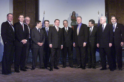 After dinner, President Clinton poses for a group photo at the Villa la Pietra with leaders who will participate in the