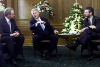 President Clinton meets with Sinn Fein President Gerry Adams and Sinn Fein leader Martin McGuinness at the Stormont Parliament Buildings in Belfast, Northern Ireland.