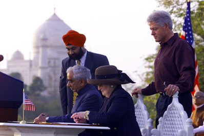 The President observes as Secretary of State Madeleine Albright and Indian Foreign Minister Singh sign an environmental partnership agreement, Taj Khema.  Agra, India.