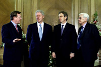 President Clinton poses for photographers with Northern Ireland First Minister David Trimble, British Prime Minister Tony Blair, and Northern Ireland's Deputy Minister Seamus Mallon