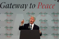 President Clinton gives a speech on the continuing peace process in Northern Ireland at the Odyssey Center in Belfast, Northern Ireland