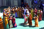 President Clinton is given a traditional greeting by women at the Naila Village outside Jaipur, India.