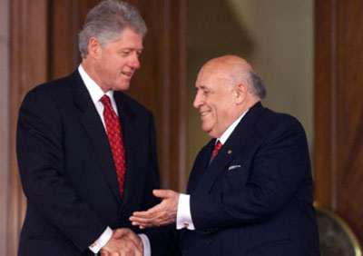 President Demirel shakes hands with President Clinton after their remarks during the arrival ceremony at the Presidential Palace.