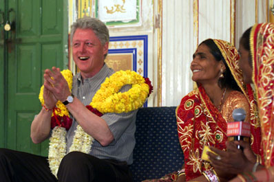 President Clinton participates in a discussion on women's empowerment at the Naila Village outside Jaipur, India.
