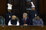 President Clinton listens with Vice President Kant and Speaker GMC Balayogi to remarks by Prime Minister Vajpayee.  Parliament Building, New Delhi.