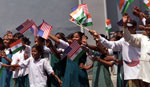 Children enthusiastically welcome President Clinton as he makes his way to the Mahavir Trust Hospital. Hyderabad, India.