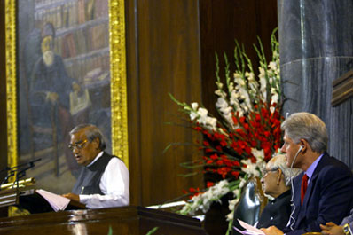 President Clinton and Vice President Kant  watch as Prime Minister Vajpayee addresses members of the two houses of Parliament. Parliament Building, New Delhi.