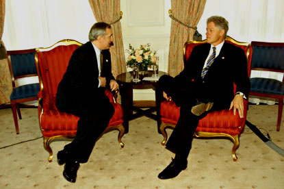 Prime Minister Ahern and President Clinton engage in a bilateral meeting.