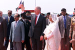 President Clinton, flanked by President Justice Shahabuddin Ahmed and Prime Minister Sheikh Hasina, waves to the crowds upon his arrival in Bangladesh.  Zia International Airport, Bangladesh.