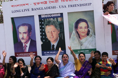 President Clinton is greeted by cheering crowds in Bangladesh.