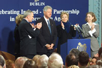 The President is introduced at the Guinness Store House in Dublin, Ireland. He is accompanied by Taoiseach Bertie Ahern, Celia Larkin, First Lady Hillary Rodham Clinton, and Chelsea Clinton.