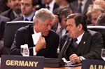 The two leaders confer at the OSCE summit.