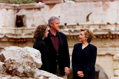 The Clintons pause to take in their surroundings.