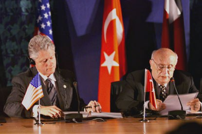 President Clinton seated beside Turkey President Demirel at the signing ceremony.