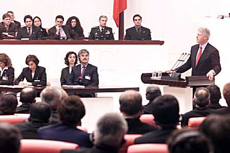 Members listen as the President addresses the Turkish Parliament, officially known as the Turkish Grand National Assembly.